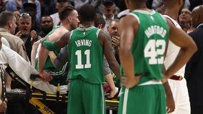 Celtics guard Kyrie Irvingconsoles Gordon Hayward after Hayward