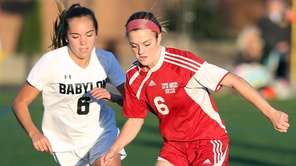 Babylon's Olivia Maldonado works against Center Moriches' Anna