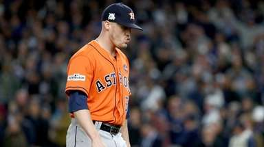 Ken Giles of the Astros walks off the