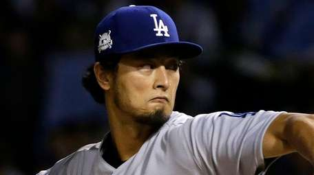 Dodgers starting pitcher Yu Darvish throws during the