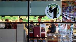 Suffolk County police investigate a robbery at a