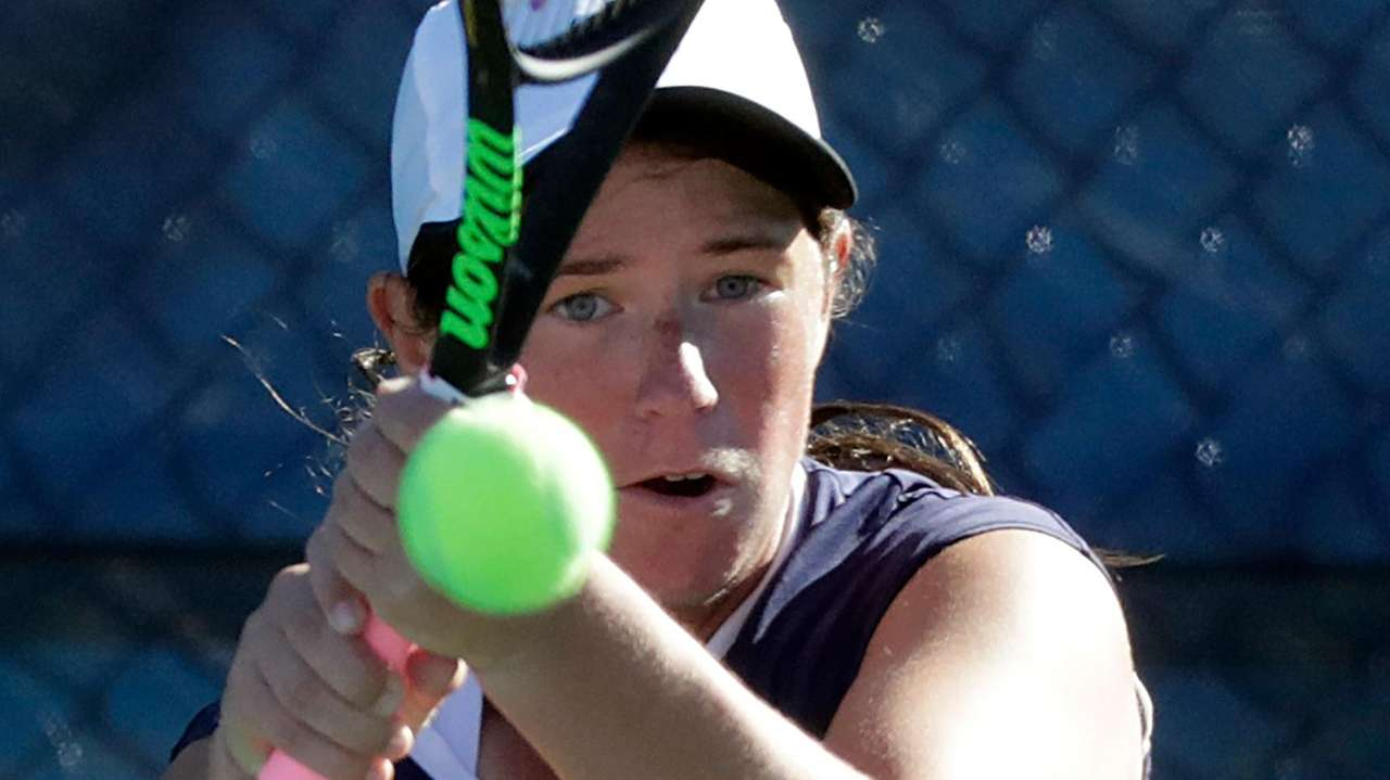 Eastport-South Manor's Jackie Bukzin with the backhand return