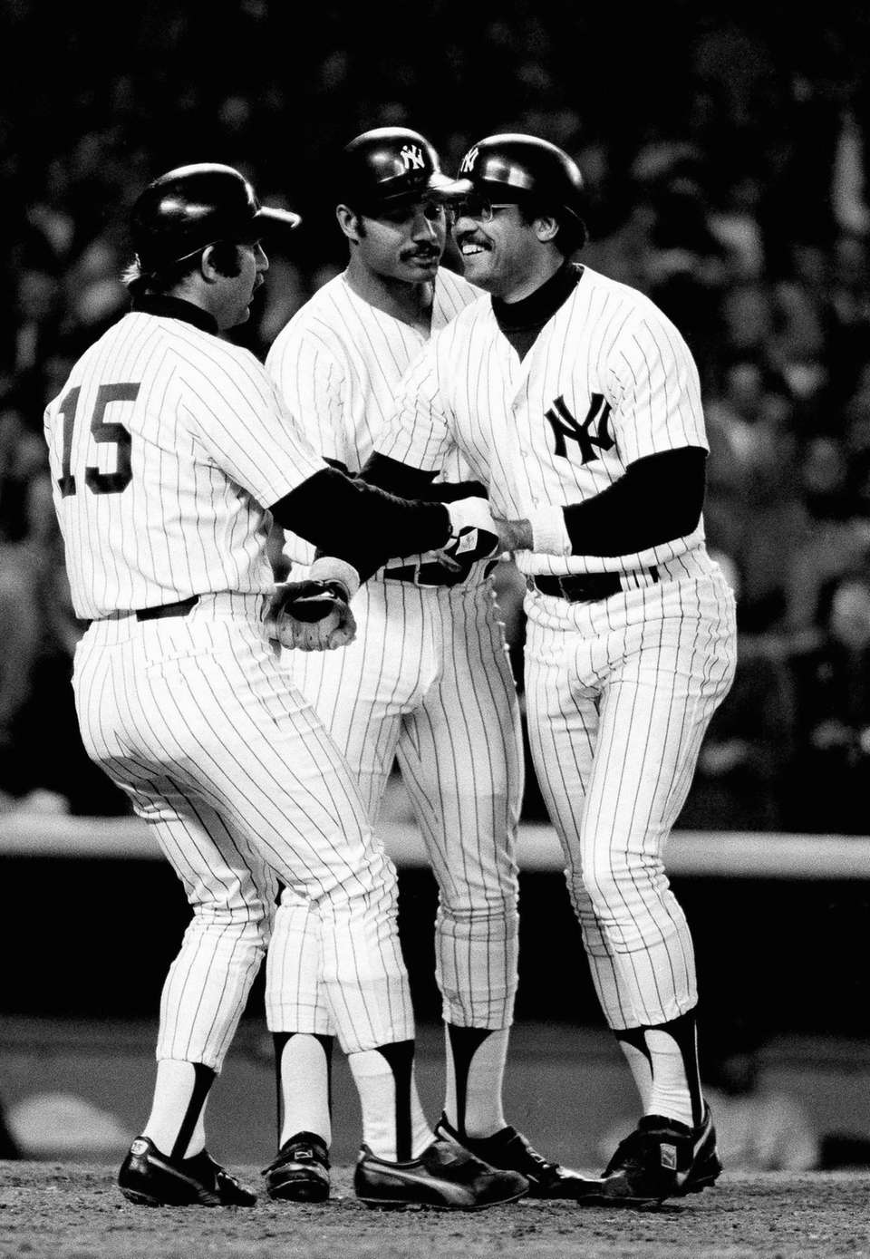 Yankees Reggie Jackson, right, is greeted by Thurman