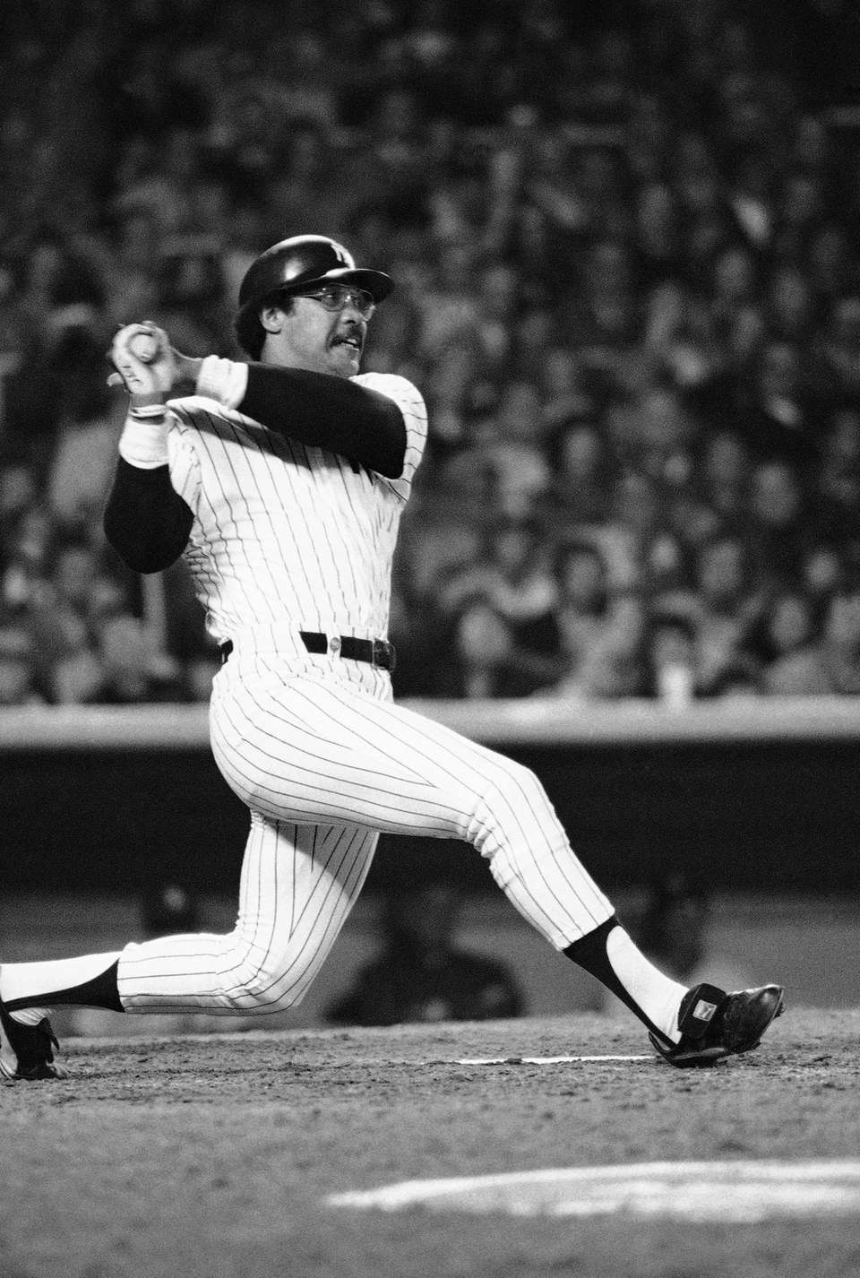 Yankees' Reggie Jackson follows through on a swing