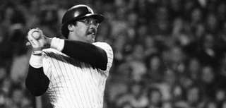 Yankees' Reggie Jackson follows through on a swing