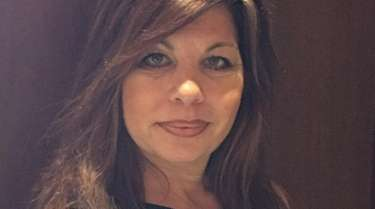 Kelly Choulis Auffret of Holtsville has been hired