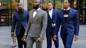 Former NFL football player Anquan Boldin, left, Philadelphia