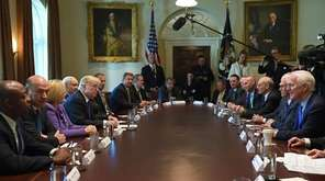 President Donald Trump, center left, meets with members