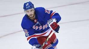 Rangers defenseman Kevin Shattenkirk skates with the puck