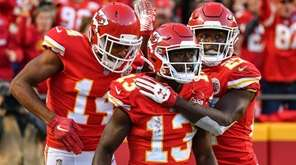 Chiefs receiver De'Anthony Thomas (13) celebrates a touchdown