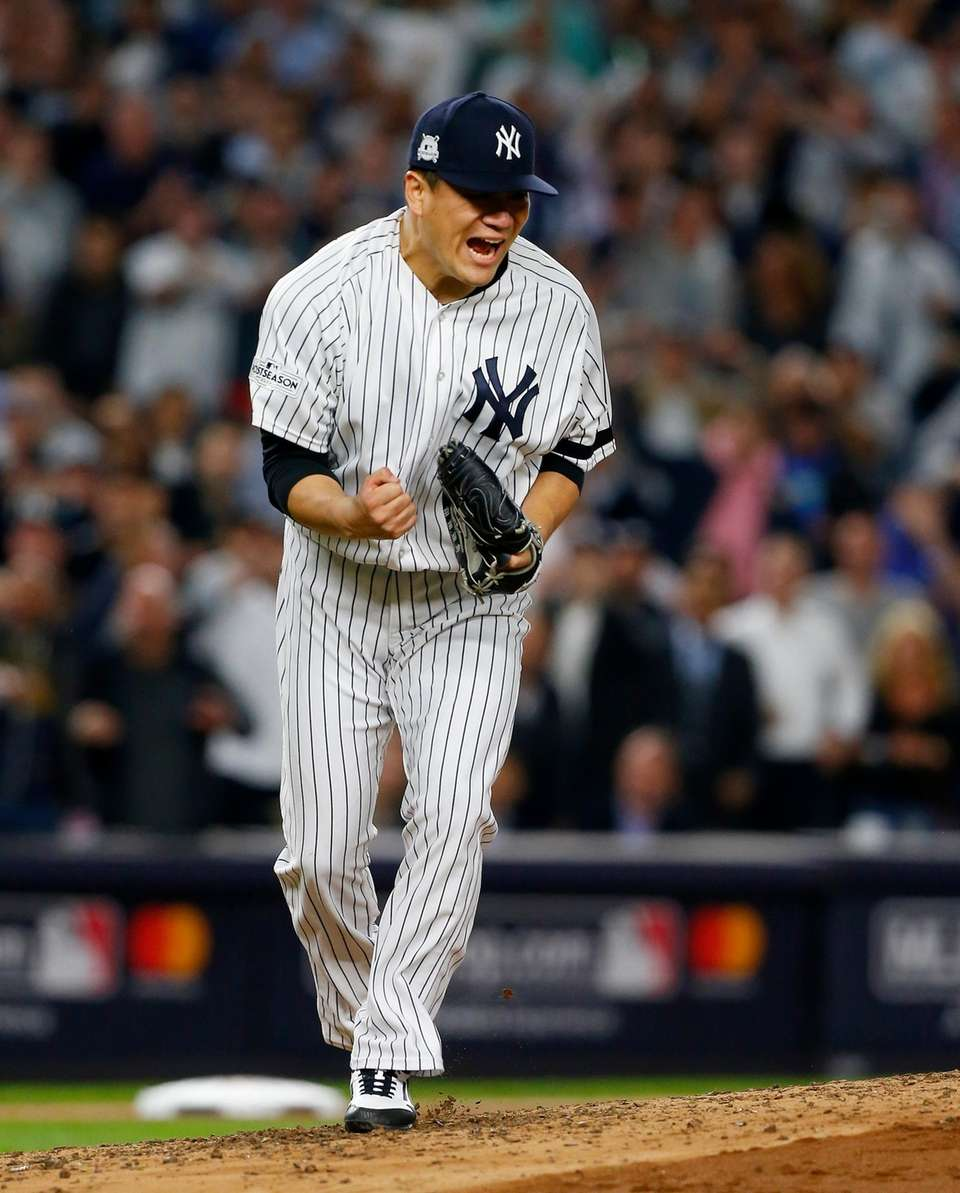 Masahiro Tanaka of the New York Yankees reacts