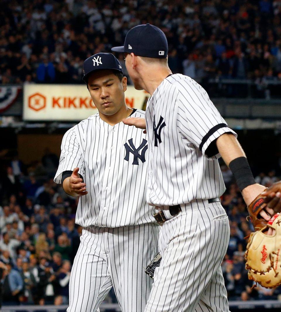 Masahiro Tanaka #19 and Todd Frazier #29 of