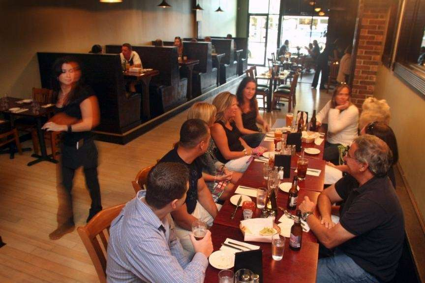 Diners gather at tables and in booths at