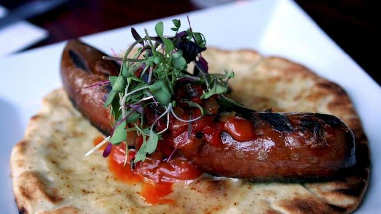 The Kobe beef frankfurter is plated at Public