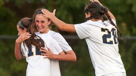 Massapequa's Kate Fiola (20, center rear), celebrates after
