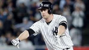 Chase Headley of the Yankees reacts after reaching