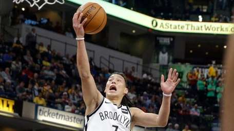 Nets guard Jeremy Lin shoots over Pacers forward