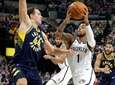 Nets guard D'Angelo Russelldrives on Pacers forward Bojan