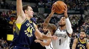 Nets guard D'Angelo Russell drives on Pacers forward Bojan