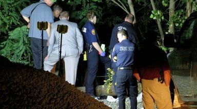 Police investigate the scene where authorities said a