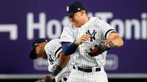 Yankees outfielders Aaron Hicks and Aaron Judge celebrate