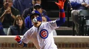 Javier Baez of the Cubs reacts after hitting a home