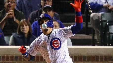 Javier Baezof the Cubs reacts afterhitting a home