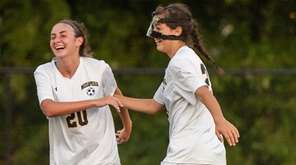 Massapequa's Kate Fiola, left, celebrates with Kayla Mushorn
