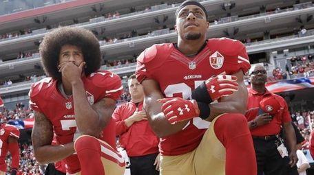 San Francisco quarterback Colin Kaepernick, left, and safety