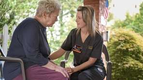 Hospice aide and end-of-life doula Ginny Gibala-Carper, right,