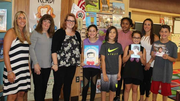 Lakeside Elementary School students in Merrick recently listened