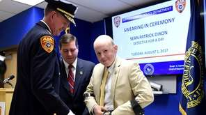 Sean Dixon, 16, with Suffolk County Police Commissioner