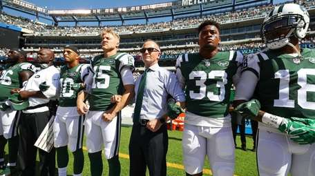 Jets CEO Christopher Johnson links arms with players