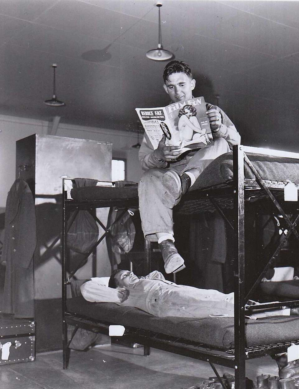 Enlisted men spend leisure time reading and relaxing