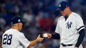 Dellin Betancesof the Yankees hands the ball to