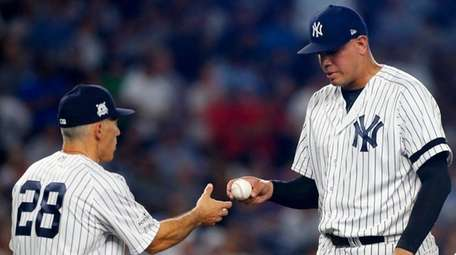 Dellin Betances of the Yankees hands the ball to
