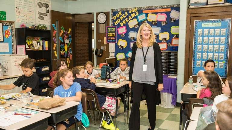 Fifth-grade teacher Kate Hunter speaks to her students