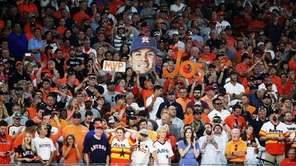 Fans hold up signs supporting Astros second baseman