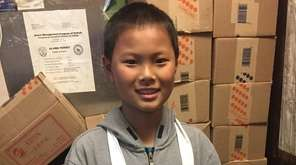 Kidsday reporter Qixin Li at his family's restaurant,
