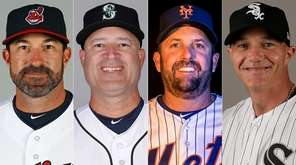 From left, Indians pitching coach Mickey Callaway, Mariners