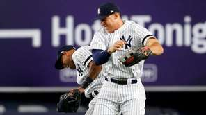 Aaron Judge and Aaron Hicks of the Yankees celebrate after