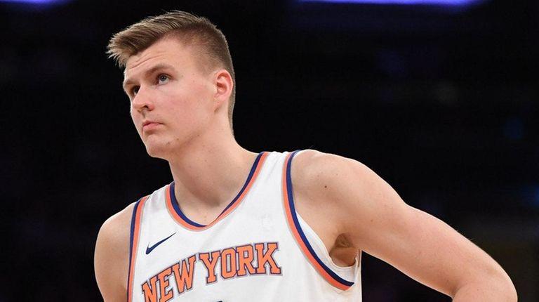 Knicks forward Kristaps Porzingis looks on during a