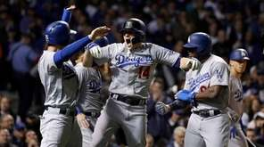 Los Angeles Dodgers' Kiké Hernandez (14) celebrates after