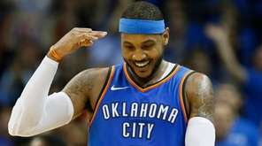 Thunder forward Carmelo Anthony gestures after hitting a