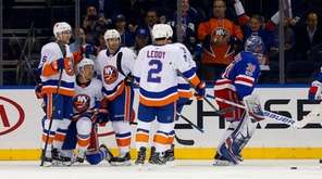 The Islanders' Anders Lee #27 celebrates his first-period