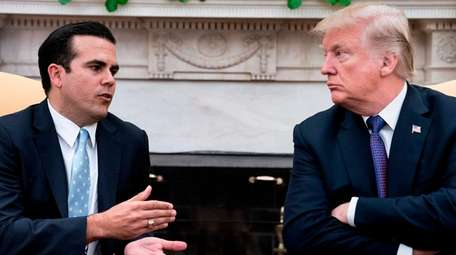 Puerto Rico Gov. Ricardo Rossello, left, and President