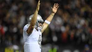 Raiders quarterback Derek Carr celebrates after a touchdown