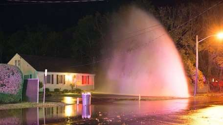 A vehicle hit a fire hydrant Friday, Oct.