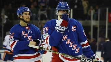 The Rangers' Brendan Smith and Ryan McDonagh leave the