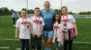 Soccer star Christie Pearce Rampone with Kidsday reporters,